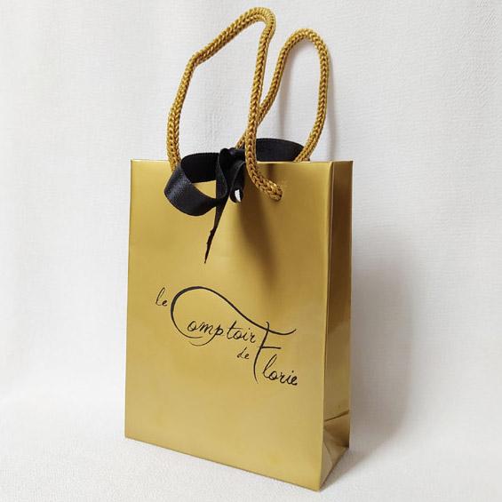 Gold branded bag
